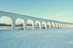 Arcade of Yaroslav courtyard and Novgorod Kremlin in Veliky Novgorod, Russia - winter view in sunny day Stock Photos