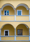 Arcade of a yellow baroque House Stock Photo