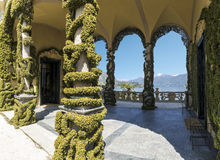 Arcaded. Arcade with ornamental trees and panoramic views of the lake and mountains Royalty Free Stock Photography