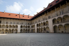 Arcaded Courtyard in Wawel Castle, Poland. Wide angle view of Arcaded Courtyard in Wawel Castle, Krakow Royalty Free Stock Photo