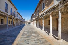 Arcaded street in Ampudia village. Medieval street, with arcaded buildings, landmark and monument from seventeenth century, in Ampudia village, Palencia, Castile Royalty Free Stock Photography