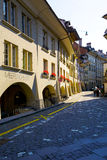 Arcades along the narrow street in Bern. BERN, SWITZERLAND - SEPTEMBER 13, 2015: Arcades along the narrow street in downtown. The total length of the arcades in Royalty Free Stock Image