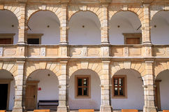 Arcades in castle in Moravska Trebova, Czech Republic. Architectural detail of the arcades in the renaissance castle in Moravska Trebova, Czech Republic. Castle Royalty Free Stock Images
