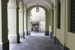 The arcades in city of Bern. Bern, Switzerland - April 17, 2017: Arcades that stretch along many streets of the old town are one of the many tourist attractions Royalty Free Stock Photo
