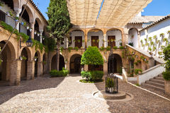 Arcades courtyard in Cordoba, Spain. Tipycal andalusian public court in Cordoba, Spain Royalty Free Stock Images