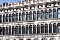 Arcades of the facade on Piazza San Marco in Venice, Italy. Arcades of the facade on Piazza San Marco Saint Mark square in Venice, Italy Royalty Free Stock Photo