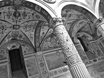 Arcades and frescoes of palazzo vecchio in florence. Black and white detail of arcades and antique frescoes of palazzo vecchio in florence, italy Stock Image