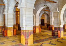 The arcades of the Grand Mosque. SOUSSE, TUNISIA - SEPTEMBER 6, 2015: The large prayer hall of the Grand Mosque is separated into the narrow areas by the huge Stock Images