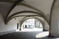 Arcades in Lucerne. LUCERNE, SWITZERLAND - MAY 02, 2016: Arcades under which passes the leaving the Spreuer Bridge (Spreuerbrucke) on the left side of the river Stock Images
