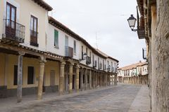 Arcades in the main street of the town of Ampudia in Palencia Spain. View of the main street of the Village of Ampudia in Palencia. Spain, with its Royalty Free Stock Image