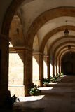 Arcades in monastery Stock Images