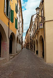 The arcades. PADUA, ITALY - APRIL 23, 2012: The medieval residential neighborhood of the city consists of such narrow winding streets with scenic arcades on the Royalty Free Stock Photography