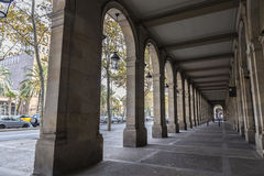 The arcades of Passeig Picasso, Barcelona. The arcades of Passeig Picasso, stately and French-inspired, are in the basement of several buildings housing built in Royalty Free Stock Image