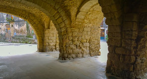 The Arcades of Peratallada town. Medieval arcades at the ancient market place of the town of Peratallada, a major tourist attraction Royalty Free Stock Photos