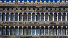 Arcades of piazza San Marco in Venice. Famous square San Marco in Venice Italy Royalty Free Stock Images