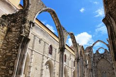 Arcades, pillars and facade of Do Carmo convent in Lisbon. Portugal Stock Image