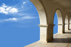 Arcades In The Sky. Ethereal image with marble arcades in a blue sky Stock Photos