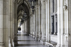Arcades in Vienna. Corridors outside Vienna's gothic City Hall (Rathaus), a building designed by Friedrich von Schmidt and built between 1872 and 1883, that Royalty Free Stock Photos