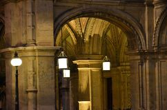Arcades of the Vienna State Opera building illuminated at night. Details of the architecture of the building of the Opera of Vienna at night Stock Photography