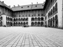 Arcades of Wawel Castle in Krakow. Courtyard with white arcades in Wawel Castle, Krakow, Poland. Black and white image Stock Images