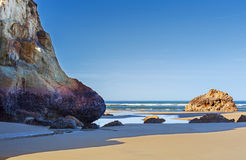 Arcadia Beach Oregon Coast. Pools of water remain near base of giant rocks at low tided on Arcadia Beach near Cannon Beach in Oregon Royalty Free Stock Photography