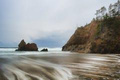 Arcadia Beach under stormy skies on Oregon Coast. Receding storm clouds hover over Arcadia Beach near Cannon Beach, Oregon Stock Photo