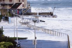 Arcadia Portrush N.Ireland. Waves cover the promenade at the Arcadia Portrush Northern Ireland. The intense storm or weather bomb was caused by a rapid fall in Stock Photo