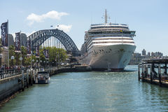 Arcadia Sydney. The P&O Cruise ship Arcadia docked at Circualr quay Sydney with the harbour bridge in the background. Copyspace Royalty Free Stock Photography