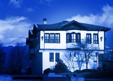An arcadian house in blue. Stock Photo