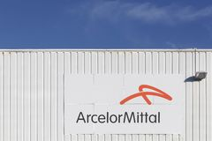 Arcelor Mittal logo on a wall. Villefranche, France - January 24, 2016: ArcelorMittal S.A. is a multinational steel manufacturing corporation headquartered in Stock Images