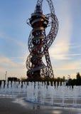 East London, UK: Arcelormittal Orbit and Fountains at sunset, Stratford. Arcelormittal Orbit and Fountains at sunset, Stratford, Olympic Park Stock Photo