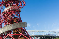 The ArcelorMittal Orbit. London England - October 17, 2016; ArcelorMittal Orbit abstract red tubular spiralling steel structure on right  with silver outer Stock Photo