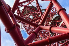 The ArcelorMittal Orbit. London, England- October 17, 2016;   close-up detailArcelorMittal Orbit , red tubular spiralling steel structure with slide inside at Royalty Free Stock Photo