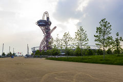 The ArcelorMittal Orbit observation tower. London, England - May 27, 2016: The ArcelorMittal Orbit observation tower and the Olympic stadium in the Queen Royalty Free Stock Photo