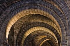 Arché medievali della pietra della chiesa Immagini Stock Libere da Diritti