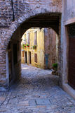 Arch. Stone arch in an alley in Croatia Stock Images