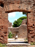 Arch. Ancient arch made of clay bricks in the ancient Ostia archaeological site near Rome, Italy Royalty Free Stock Photography