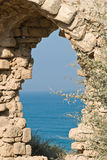 Arch. Fragment of ancient arch on the mediterranean sea in Israel royalty free stock photography