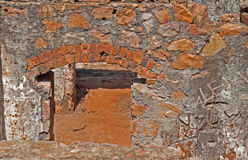 ARCH ABOVE DOOR OPENING IN OLD FORT. Interior structure of old fort in ruins Royalty Free Stock Images