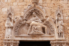 The arch above the entrance in catholic temple. In Dubrovnik, Croatia Royalty Free Stock Photo