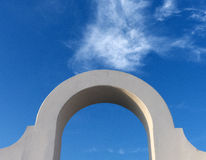 Arch against a blue sky. Close-up of one of many arches seen in Sperlonga, Italy Stock Image