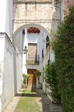 Arch in alley. Stone arch in white alley located in the jewish quarter of Cordoba, Andalusia, Spain Stock Photos