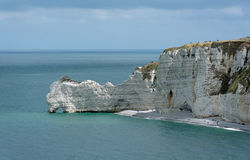 Cliffs of Etretat in Normandy coast Stock Photos