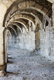 Arch in ancient amphitheater. Arch corridor ancient amphitheater of Aspendos old ruin, Turkey Royalty Free Stock Images