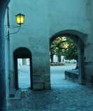 Arch in ancient castle. Yellow light in blue green Royalty Free Stock Images