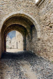 Arch of the ancient fortress. Dark tunnel corridor with arch of the ancient fortress Stock Images