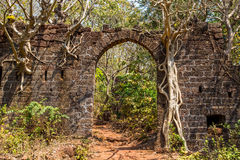 Arch at ancient fortress wall. Redi fort (Yashwantgad Fort). Ind. Arch at ancient fortress wall. Redi fort (Yashwantgad Fort). India Royalty Free Stock Photo