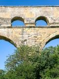 Arch of ancient Roman aqueduct Pont du Gard. Travel to Provence, France - arch of ancient Roman aqueduct Pont du Gard near Vers-Pont-du-Gard town Stock Image