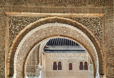 Arch with arabesque in Alhambra, Spain. Arch with stone relief with arabesques in Alhambra palace, Spain Royalty Free Stock Image