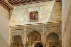 Arch with arabesque in Alhambra, Spain. Arch with stone relief with arabesques in Alhambra palace, Spain Stock Images